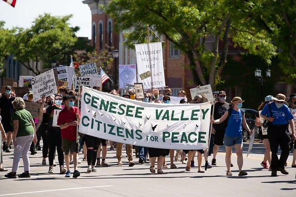 marchers with GVCP Banner in Geneseo, NY